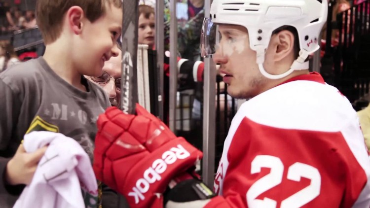 A hockey player's small act of kindness brought SO MUCH JOY to this young fan