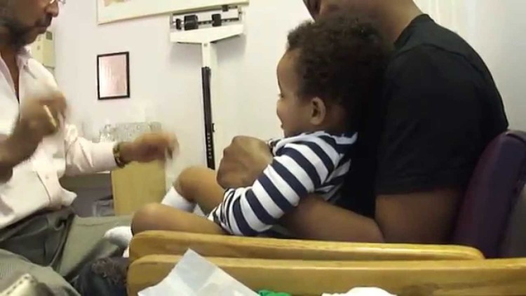 This Doctor Is Part Baby Whisperer! He Makes His Little Patient Laugh While Giving His Shots.